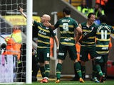 QPR's Andy Johnson celebrates with team mates after scoring the opening goal against Bolton on August 24, 2013