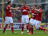 Forest's Andy Reid is congratulated by team mates after scoring the opening goal against Watford on August 25, 2013