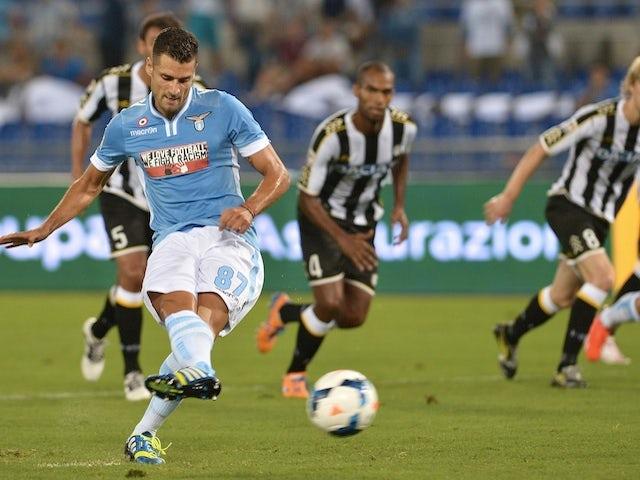 Lazio's Antonio Candreva scores a penalty against Udinese on August 25, 2013