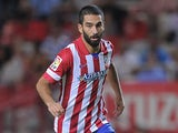 Atletico Madrid's Arda Turan in action against Sevilla on August 18, 2013