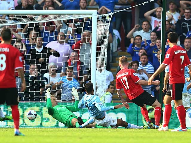 Cardiff's Aron Gunnarsson scores the equaliser against Manchester City on August 25, 2013