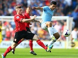 Cardiff's Aron Gunnarsson and Manchester City's Sergio Aguero battle for the ball on August 25, 2013
