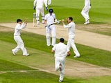 Australian players celebrate during play on the third day of the fifth Ashes cricket test match between England and Australia at the Oval in London on August 23, 2013