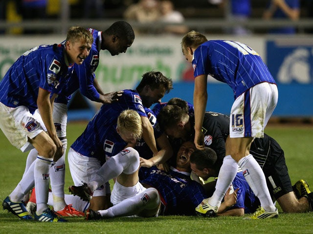 David Symington of Carlisle United is congratulated by team mates after scoring the winning goal in the penalty shoot out during the Capital One Cup first round match between Carlisle United and Blackburn Rovers at Brunton Park on August 7, 2013