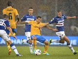 Juve striker Carlos Tevez shields the ball in rain soaked conditions against Sampdoria on August 24, 2013