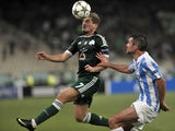 Panathinaikos Athens Charis Mavrias vies Malaga Ignacio Camacho during their UEFA Champions league playoffs second leg football match Panathinaikos vs Malaga at the Olympic stadium in Athens on August 28, 2012