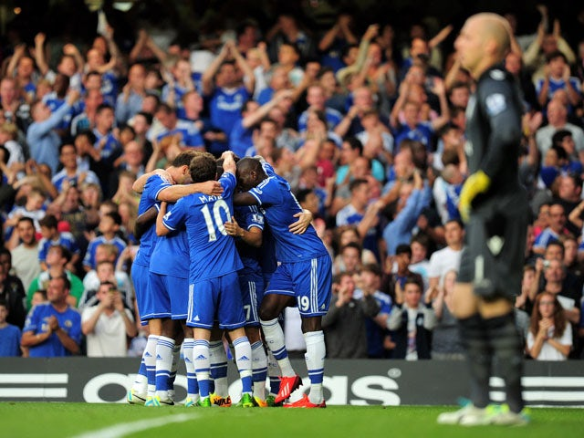 Chelsea players celebrate the first goal in their Premier League clash with Aston Villa on August 21, 2013