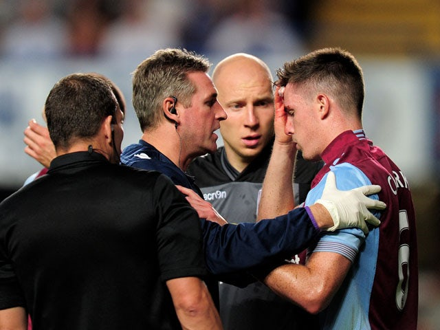 Ciaran Clark of Aston Villa receives treatment for a cut to his head during the Barclays Premier League match between Chelsea and Aston Villa at Stamford Bridge on August 21, 2013