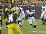 Seahawks' Christine Michael makes a play against Green Bay on August 23, 2013