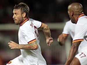 Roma's Daniele De Rossi celebrates a goal against Livorno on August 25, 2013
