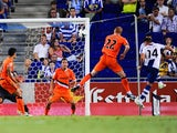 Espanyol's David Lopez heads home against Valencia on August 24, 2013
