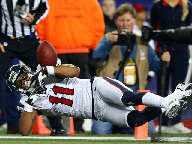 DeVier Posey #11 of the Houston Texans brings in a catch for a touchdown in the fourth quarter against the New England Patriots during the 2013 AFC Divisional Playoffs game at Gillette Stadium on January 13, 2013