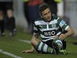 Sporting's Diego Capel sits dejected after a missed chance against Pacos Ferreira  on May 5, 2013