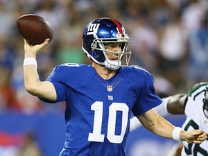 New York Giants' Eli Manning in action against New York Jets on August 24, 2013