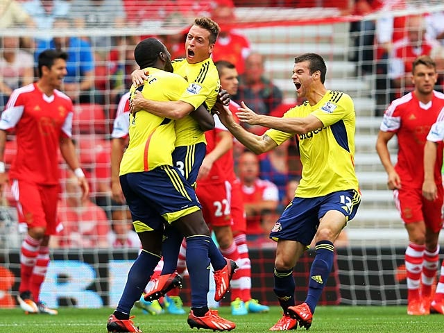 Sunderland's Emanuele Giaccherini is mobbed by team mates after scoring the opening goal against Sunderland on August 24, 2013