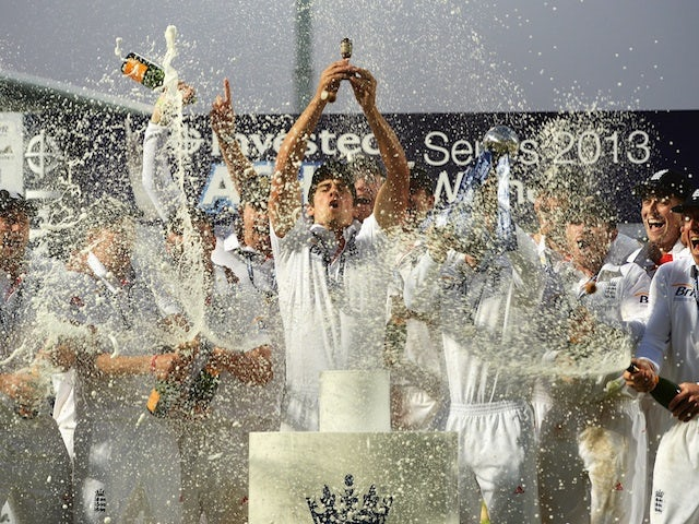 England skipper Alistair Cook holds the urn after his side secure the Ashes on August 25, 2013