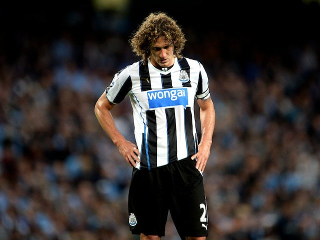 Newcastle's Fabricio Coloccini stands dejected with his side two down at Man City on August 19, 2013