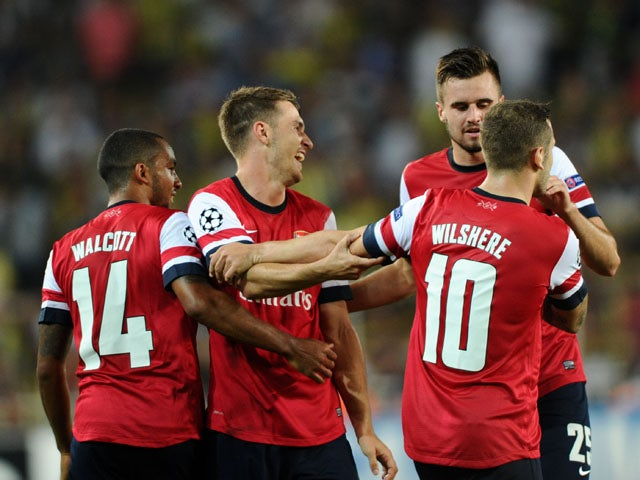 Arsenal's Aaron Ramsey celebrates with teammates after scoring the second goal against Fenerbahce during their UEFA Champions League Play Off first leg match at Sukru Saracoglu Stadium in Istanbul on August 21, 2013