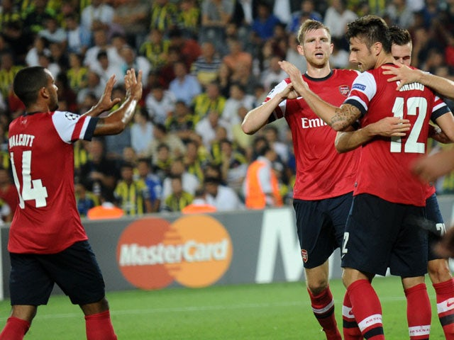 Arsenal's Olivier Giroud celebrates with teammates after scoring the third goal against Fenerbahce during their UEFA Champions League Play Off first leg match at Sukru Saracoglu Stadium in Istanbul on August 21, 2013