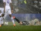 Reims forward Gaetan Courtet slides in the rain against Lyon on August 24, 2013