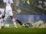 Reims forward Gaetan Courtet slides in the rain against Lyon on August 24, 2013