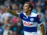 QPR midfielder Gary O'Neil in action against Ipswich on August 17, 2013