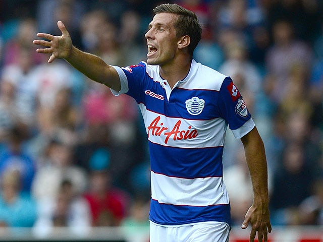 QPR's Gary O'Neil in action during the match against Ipswich on August 17, 2013