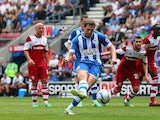 Wigan's Grant Holt scores the opening goal from the penalty spot during the match against Middlesbrough on August 25, 2013