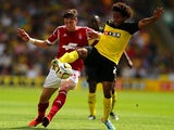 Watford's Ikechi Anya and Forest's Greg Halford battle for the ball on August 25, 2013