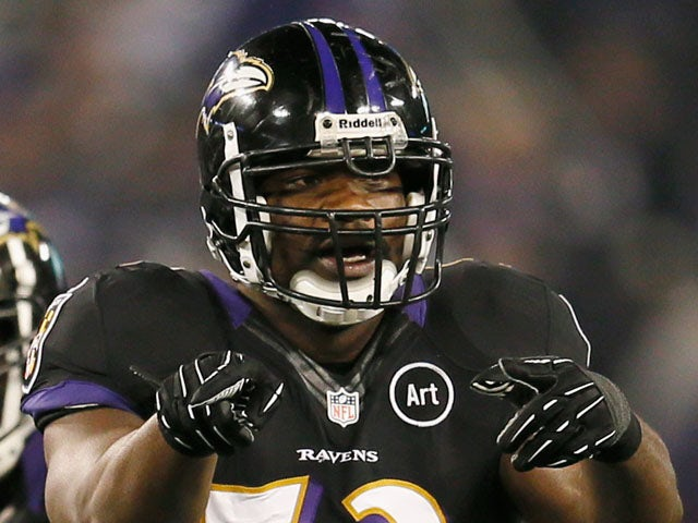 Inside linebacker Jameel McClain #53 of the Baltimore Ravens motions at the line of scrimmage against the Pittsburgh Steelers at M&T Bank Stadium on December 2, 2012