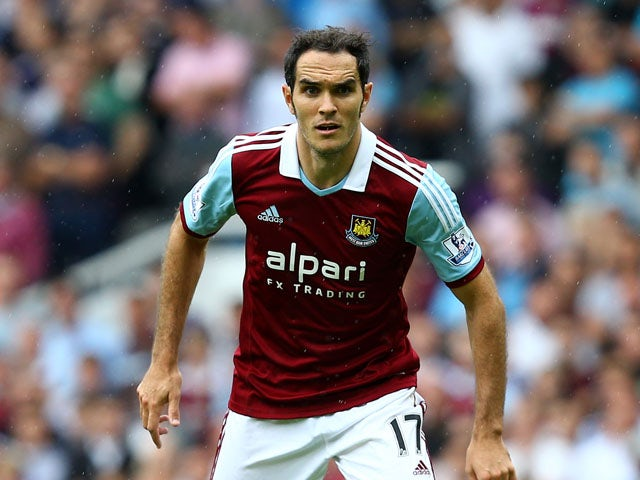 Joey O'Brien of West Ham United controls the ball during the Barclays Premier League match between West Ham United and Cardiff City at the Bolyen Ground on August 17, 2013