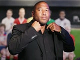 John Barnes prepares for a TV interview during the Football Association's Royal Mail Stamp Launch at Wembley Stadium on May 8, 2013