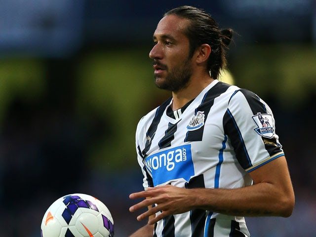 Jonas Gutierrez of Newcastle United takes a throw in during the Barclays Premier League match between Manchester City and Newcastle United at the Etihad Stadium on August 19, 2013