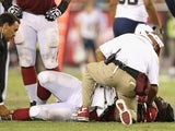 Cards' Jonathan Cooper lays stricken with a broken leg during a game with San Diego on August 24, 2013