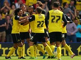 Watford's Lewis McGugan is mobbed by team mates after scoring the equaliser against Forest on August 25, 2013