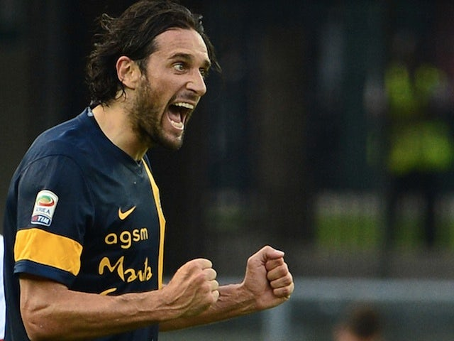 Verona's Luca Toni celebrates a goal against AC Milan on August 24, 2013