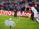Luis Figo is pelted with lighters and coins as he prepares to take a corner.
