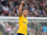 Arsenal's Lukas Podolski celebrates after scoring his team's second goal against Fulham on August 24, 2013
