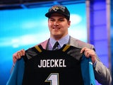 Luke Joeckel of the Texas A&M Aggies holds up a jersey on stage after he was picked #2 overall by the Jacksonville Jaguars in the first round of the 2013 NFL Draft at Radio City Music Hall on April 25, 2013