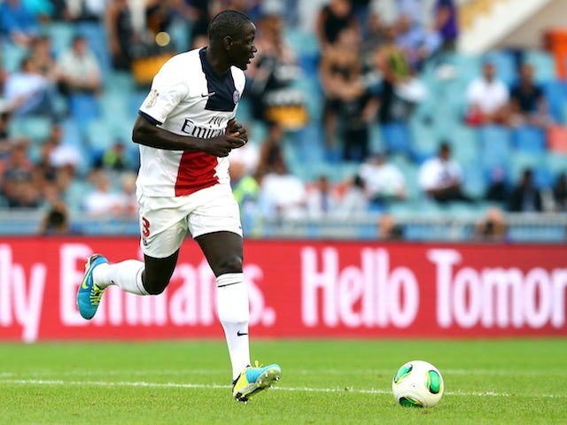 PSG defender Mamadou Sakho runs with the ball against Real Madrid on July 27, 2013
