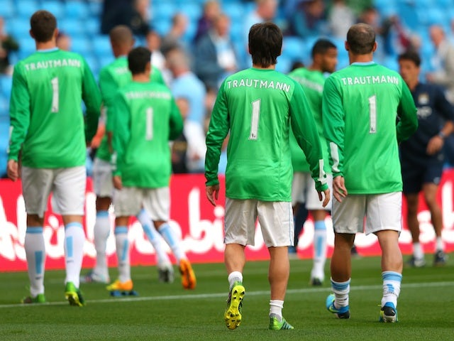 City players pay homage to legendary 'keeper Bert Trautmann, during the warming of the game with Newcastle on August 19, 2013