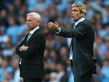 Opposing managers Manuel Pellegrini and Alan Pardew on the touchline on August 19, 2013