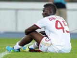 Milan's Mario Balotelli sits dejected after defeat to Verona on August 24, 2013