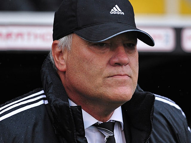 Fulham manager Martin Jol prior to kick-off in the match against Arsenal on August 24, 2013