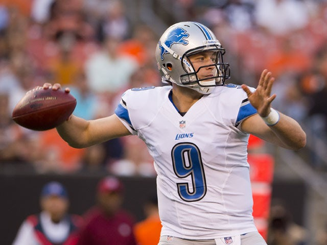 Quarterback Matthew Stafford #9 of the Detroit Lions looks for a pass during the first half against the Cleveland Browns of a preseason at FirstEnergy Stadium on August 15, 2013