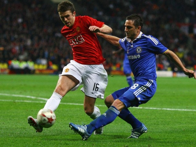 Michael Carrick blocks a cross from Frank Lampard.