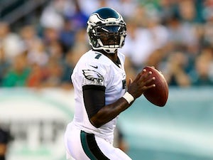 Michael Vick #7 of the Philadelphia Eagles looks to pass in the first quarter against the New England Patriots on August 9, 2013