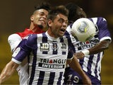 Monaco's French forward Emmanuel Riviere vies with Toulouse Serbian defender Pavle Ninkov and defender Serge Aurier during a French L1 football match between Monaco and Toulouse on August 23, 2013