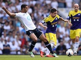 Tottenham's Nacer Chadli and Swansea's Pablo Hernandez battle for the ball on August 25, 2013