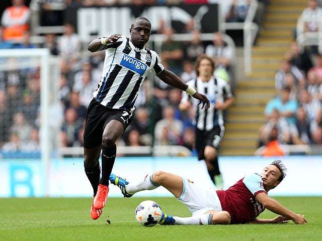 Newcastle's Moussa Sissoko and West Ham's Mark Noble battle for the ball on August 24, 2013